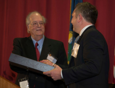 Carlo D'Este shakes hands with an award honoree at the 2018 Military Writers' Symposium.